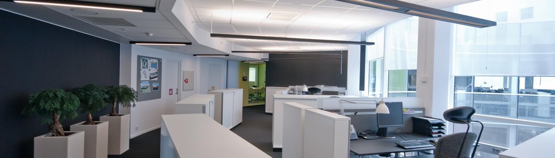 Åpent kontorlandskap i kontorbygg tegnet av interiørarkitekt Anne Berentsen
